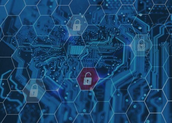 Symbolbild für Hackerangrifft mit Platine und Schloss-Symbolen